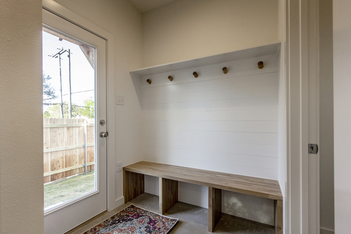 Home Design Accents: mudroom with butcher block seating and oak dowels