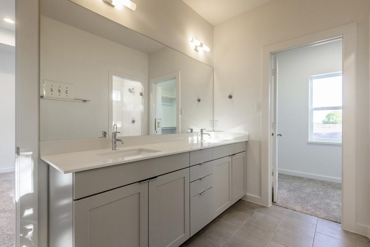 Bathroom Design (Custom Texas Homes): Master Bath with Grey Cabinets