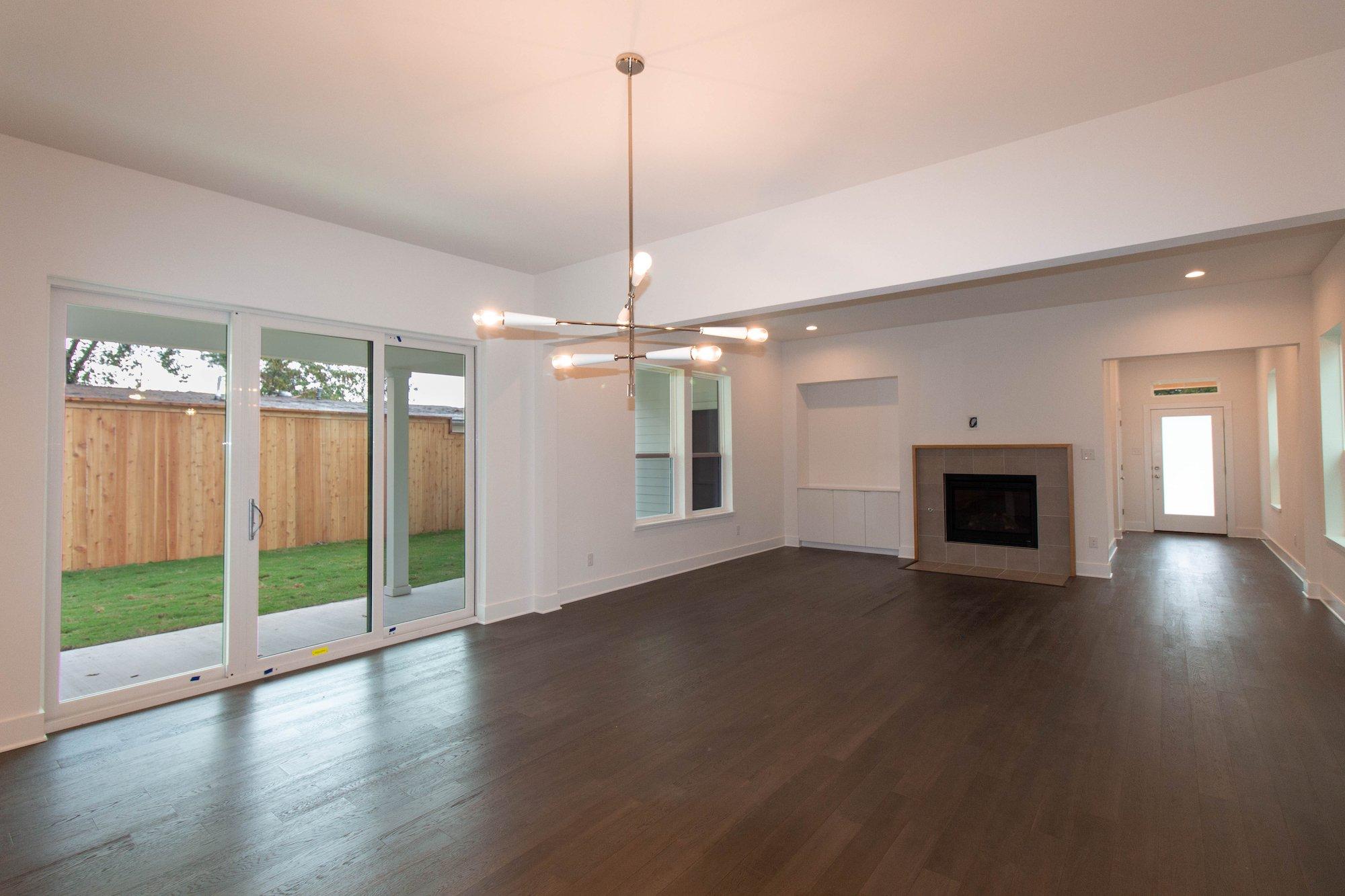Living Room Design (Texas Homes): living room with 3-panel sliding door