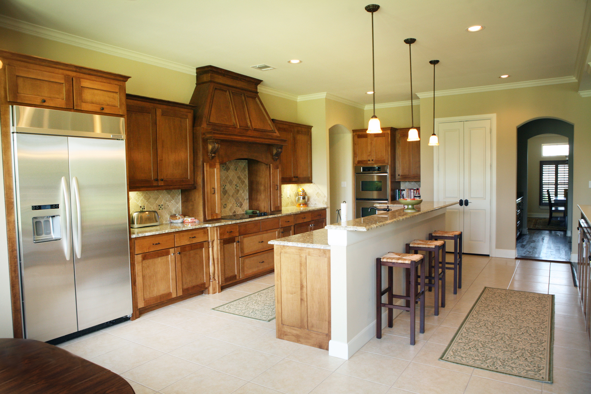 Hedgefield Homes Kitchen Design: Stained Custom Maple Kitchen with Stainless Appliances