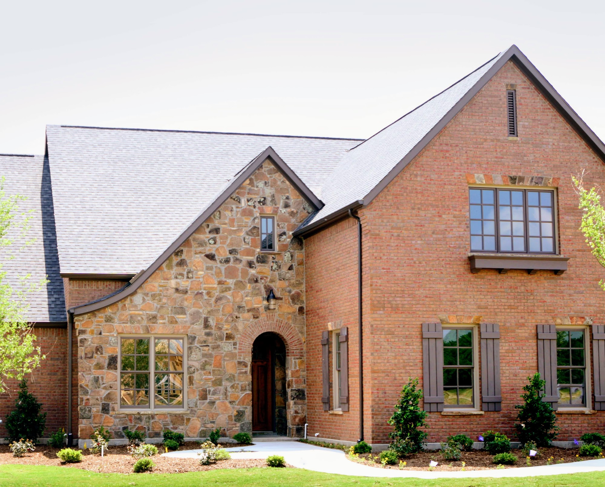 Exterior Home Design (North Texas): brick and stone with wood windows front exterior