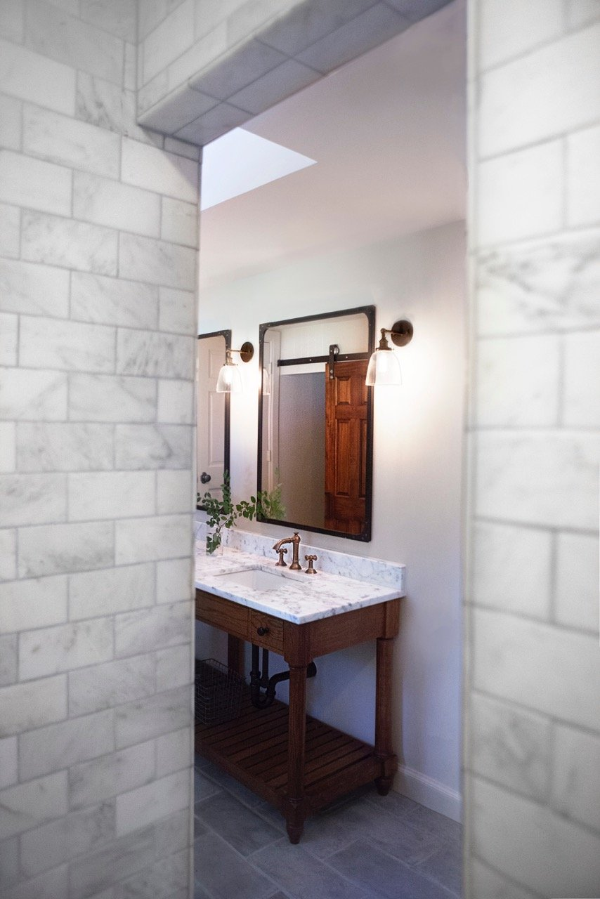Bathroom Design (Custom Texas Homes): Cararra Tile and Custom Furnityre Vanity with Restoration Hardware
