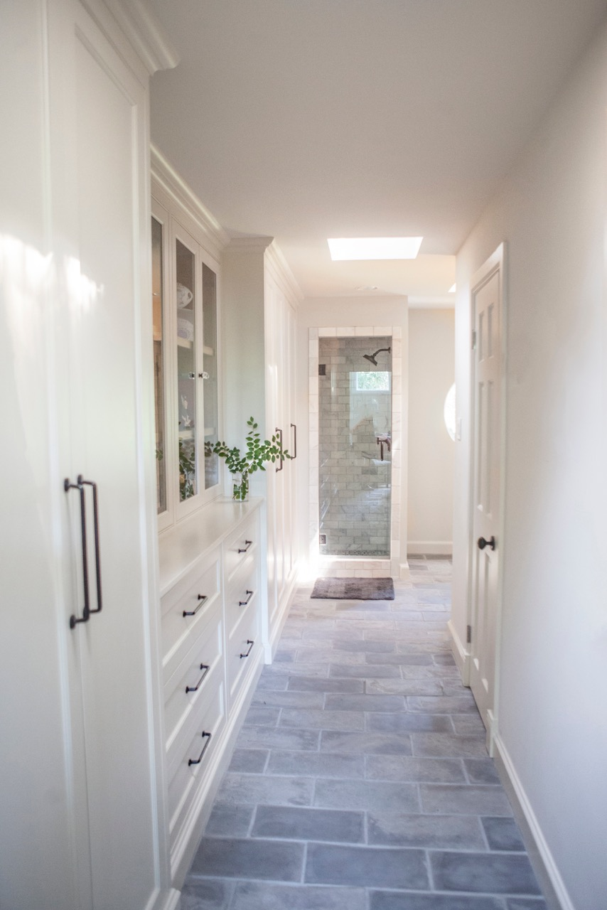 Bathroom Design (Custom Texas Homes): custom built in cabinetry and closet with stone tile