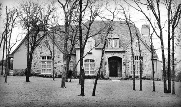 Exterior Home Design (North Texas): Brick and Stone Tudor in the Trees During Winter