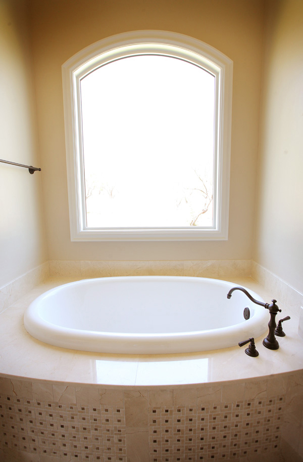 Bathroom Design (Custom Texas Homes): Rohl Faucet and Bow Front Tub with Marble Tile
