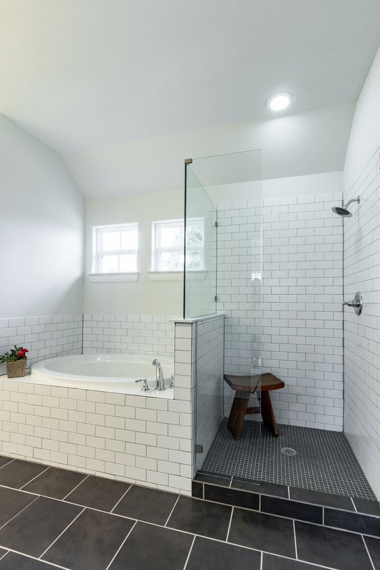 Bathroom Design (Custom Texas Homes): Tiled Bathroom With White on Black Theme