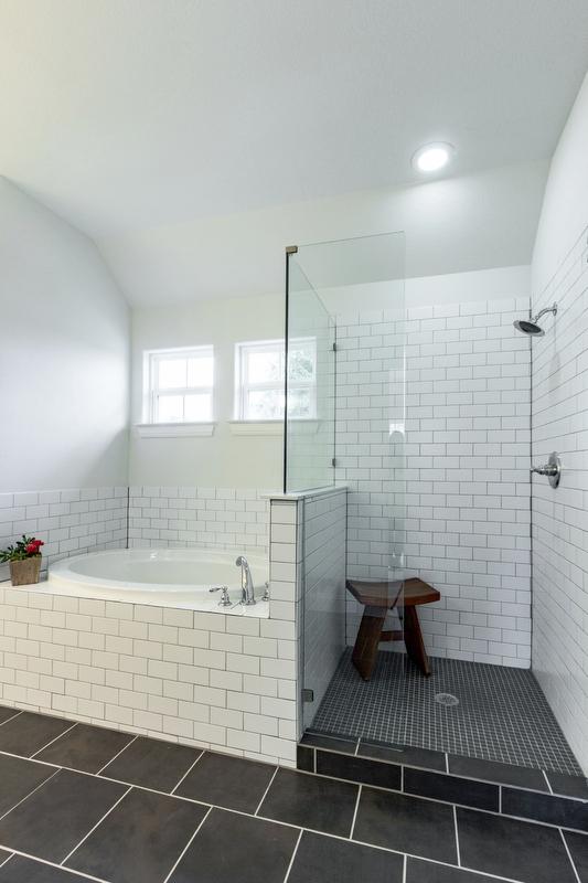 Bathroom Design (Custom Texas Homes): Tiled Bathroom With White on Black Theme