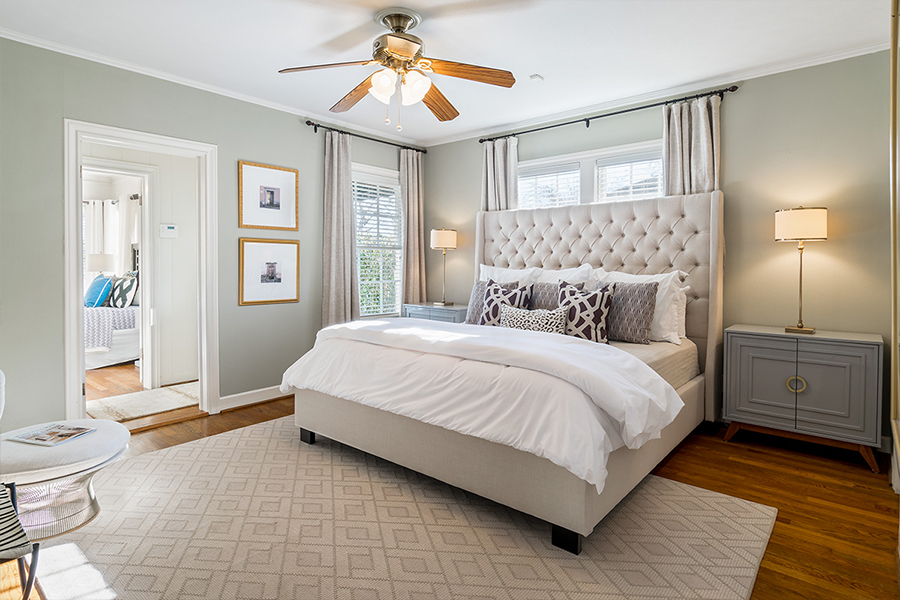 Bedroom Custom Home Design: Tufted Master Bed With Ceiling Fan and Oak Floors