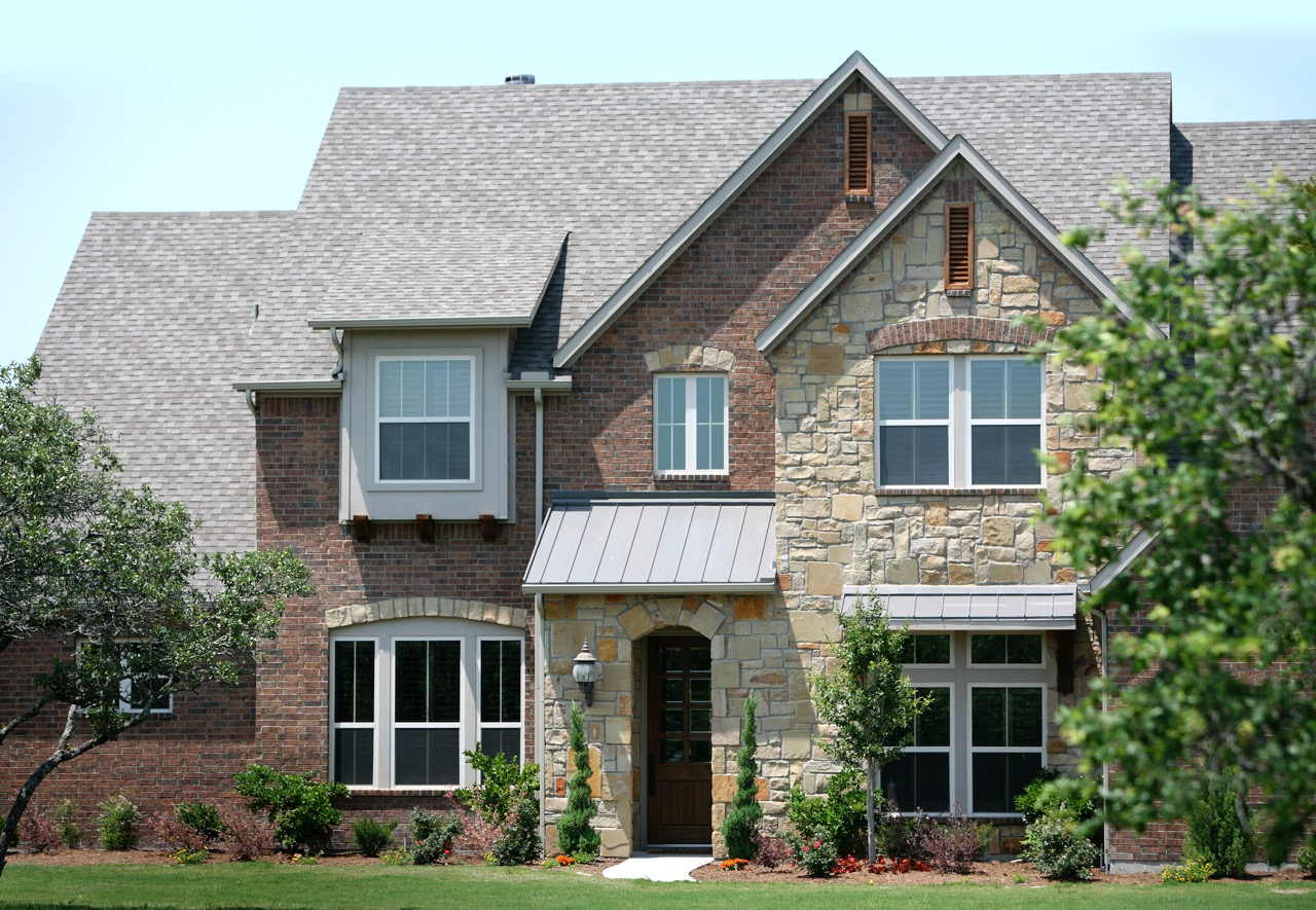 Exterior Home Design (North Texas): Brick and stone home in aledo tx