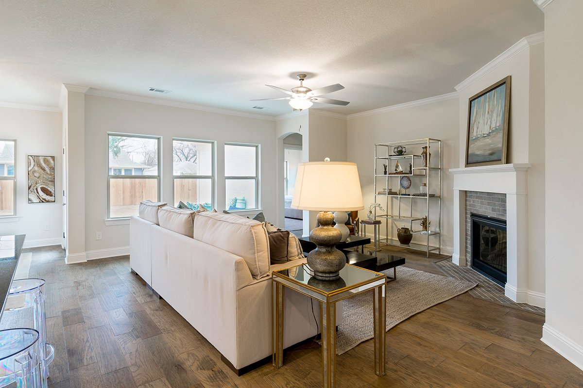 Living Room Design (Texas Homes): cream sectional and washed hardwood floors