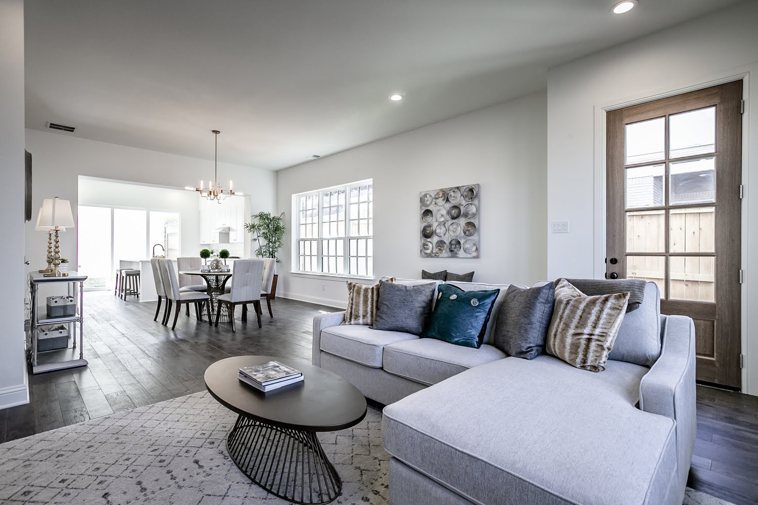 Living Room Design (Texas Homes): living and dining room with furniture and mahogany door