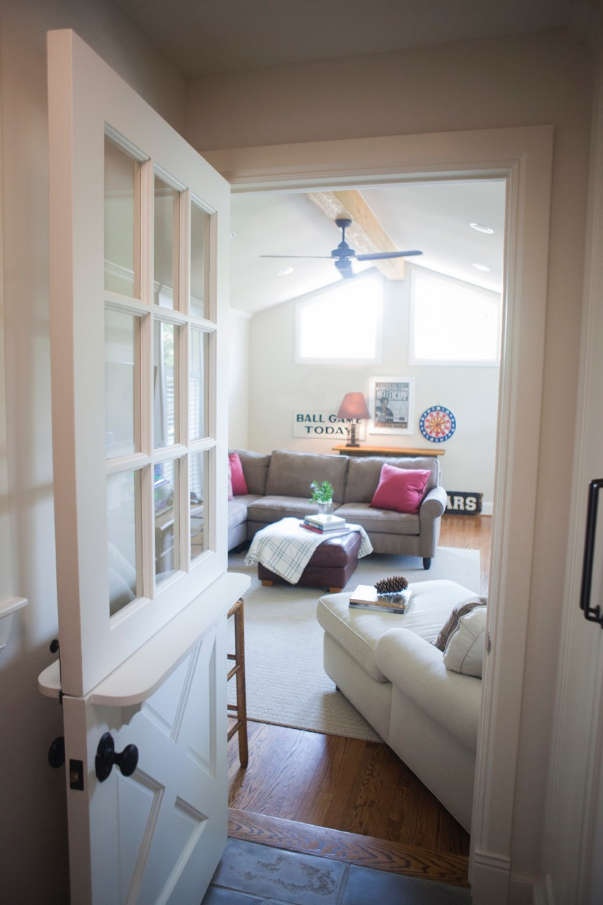 Living Room Design (Texas Homes): game room with dutch door and vaulted ceiling