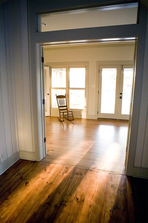 Living Room Design (Texas Homes): rocking chair in music room with stained pine floors