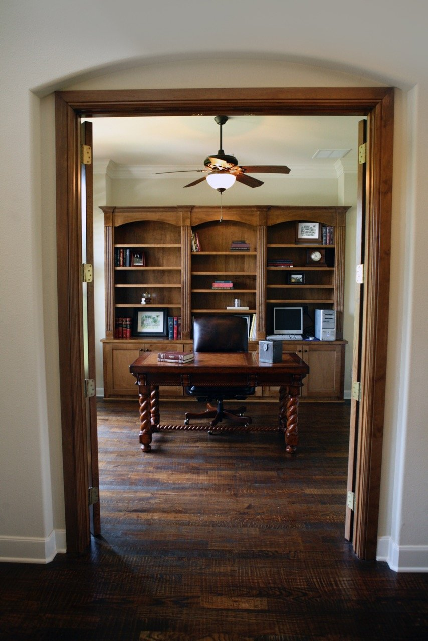Living Room Design (Texas Homes): stained woodwork in study