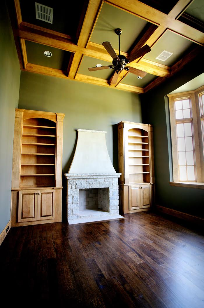 Living Room Design (Texas Homes): palencia study with fireplace and maple wood work
