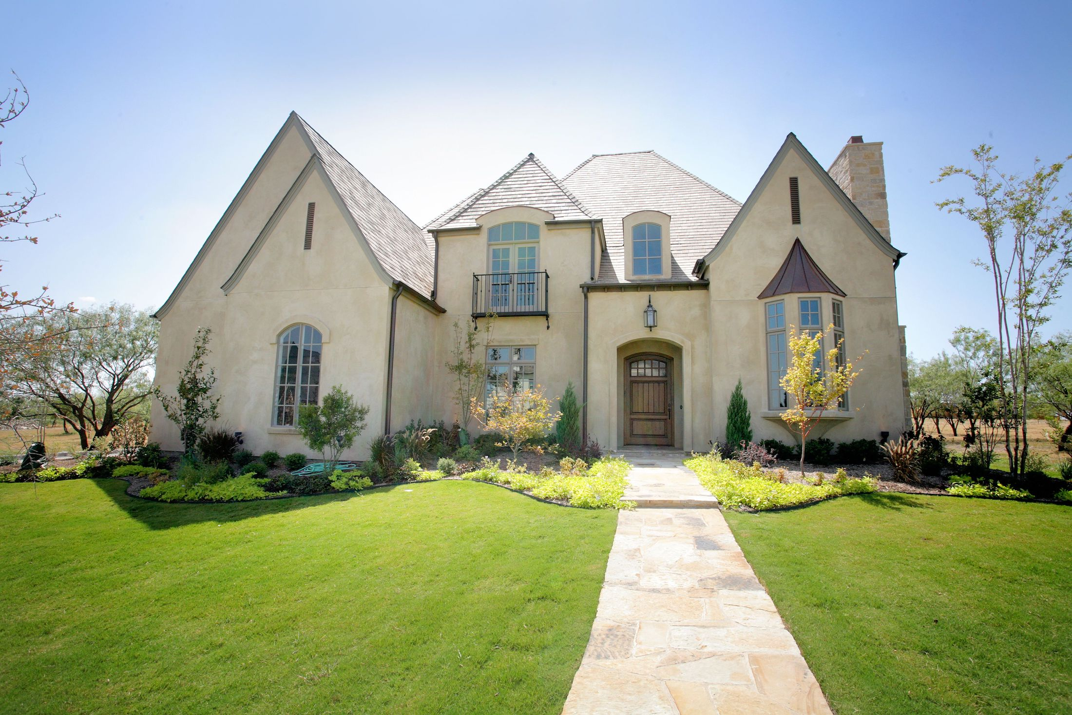 Exterior Home Design (North Texas): Stucco French Norman Home