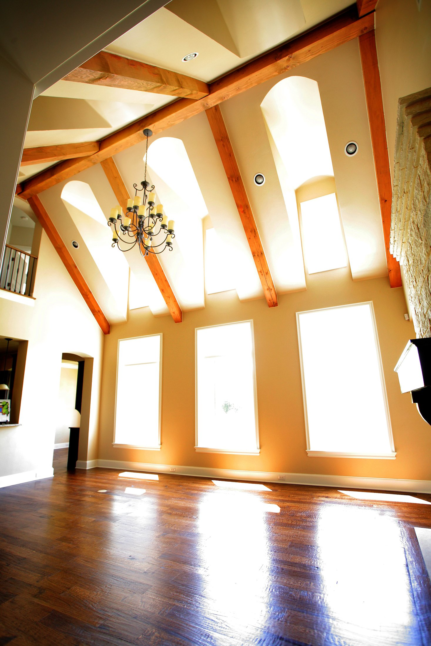 Living Room Design (Texas Homes): Timbers in Vaulted Ceiling with Dormers