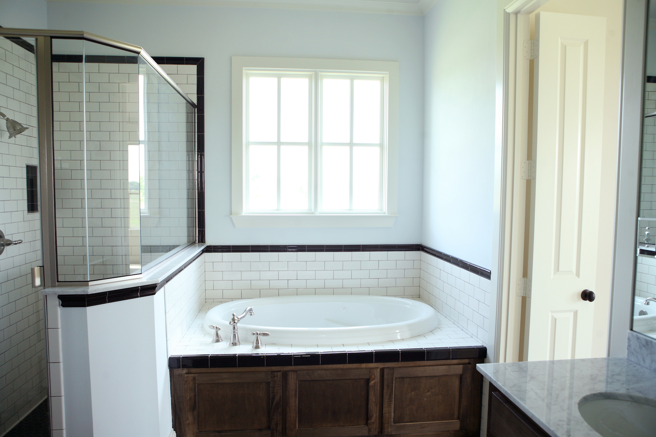 Bathroom Design (Custom Texas Homes): Tiled Tub Deck With Maple Front and Shower